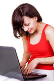 Girl with laptop. Girl browsing on a laptop over white Stock Photos