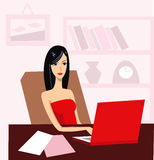 Girl with laptop. Black-haired young woman with a red laptop in office Stock Photo