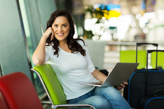Girl laptop airport Royalty Free Stock Photography
