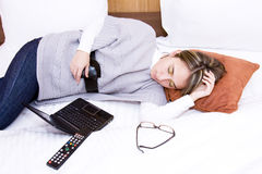 Girl with a laptop on the bed at home, sleeping Stock Photo