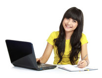 Girl with laptop and book Royalty Free Stock Photography