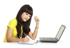 Girl with laptop and book Royalty Free Stock Photo