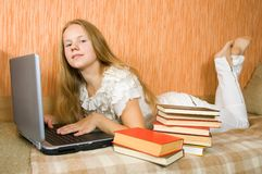 Girl  with laptop and books Royalty Free Stock Photos