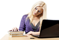 Girl of the laptop with the books Royalty Free Stock Image