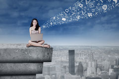 Girl with laptop on the building roof Royalty Free Stock Photos