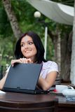 Girl with laptop in cafe Royalty Free Stock Photo