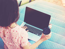 Girl with laptop and coffee Stock Photos