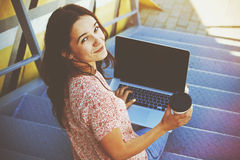 Girl with laptop and coffee Stock Photo