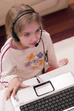 Girl and laptop computer Royalty Free Stock Photos