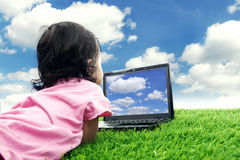 Girl with laptop computer outdoor Stock Photography