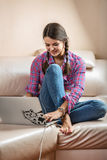 The girl and a laptop on the couch. Stock Photo