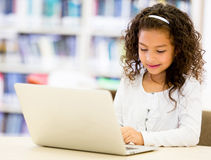 Girl with a laptop cpmputer Royalty Free Stock Images