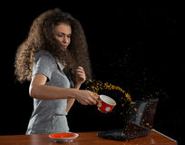 The girl, a laptop and a cup of coffee Royalty Free Stock Photography