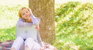 Girl laptop dreaming in park sit on grass. Dream about successful project. Woman dreamy with laptop work outdoors stock image