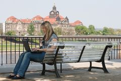 Girl with laptop in Dresden on the bank of the Elb Royalty Free Stock Photography
