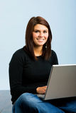Girl on laptop on floor Royalty Free Stock Photography