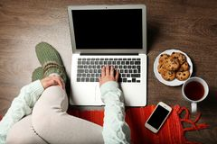 Girl with laptop and food relaxing Stock Photo