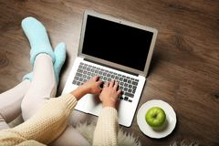 Girl with laptop and food relaxing Stock Images