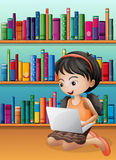 A girl with a laptop in front of the wooden shelves Stock Photos