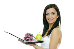 Girl with laptop and fruits Royalty Free Stock Photos