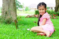 Girl with a laptop in the garden Royalty Free Stock Images