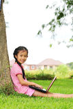 Girl with a laptop in the garden Royalty Free Stock Photos