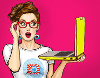 Girl with laptop in the hand in comic style. Woman with notebook.Girl in glasses. Hipster girl. Digital advertisement. Amazed woman. Comic woman