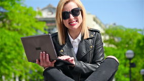 Girl With Laptop. Happy Hipster Girl Sitting With Laptop In Hand stock video footage