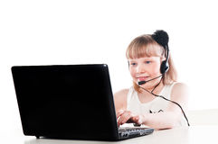 Girl with a laptop and headset Stock Photo