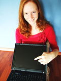 Girl with Laptop at Home Stock Photography