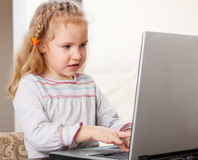 Girl with laptop at home Royalty Free Stock Image