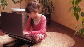 Girl with a laptop at home. stock video footage