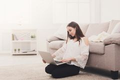 Girl with laptop indoors Stock Image