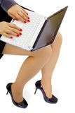 Girl with laptop on lap Stock Photo