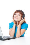 A girl with a laptop is listening to the music Royalty Free Stock Photo