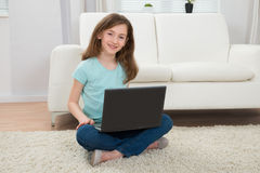 Girl With Laptop In Living Room Royalty Free Stock Photography
