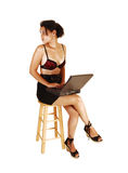 Girl with laptop looking back. Royalty Free Stock Photos