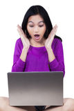 Girl with laptop looks shocked Stock Image