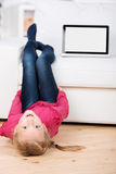 Girl With Laptop Lying On Floor Royalty Free Stock Photos
