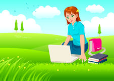 Girl With Laptop On Meadow Stock Photography