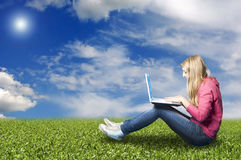 Girl with laptop in nature Stock Photos