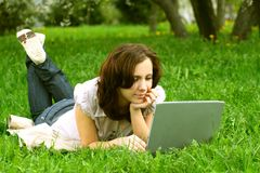 The girl with laptop on nature Royalty Free Stock Photo