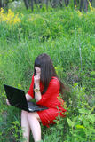 The girl with laptop on the nature Stock Photography
