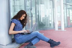 Girl on laptop outdoor Stock Image