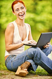 Girl with laptop outdoors Royalty Free Stock Photo