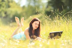 Girl with laptop outdoors Stock Photos