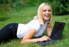 Girl with laptop outside Royalty Free Stock Images