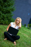 Girl with laptop outside Stock Photography