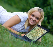 Girl with laptop outside Stock Photo