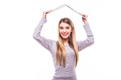 Girl with laptop over head. Blonde girl with laptop over head Stock Photos